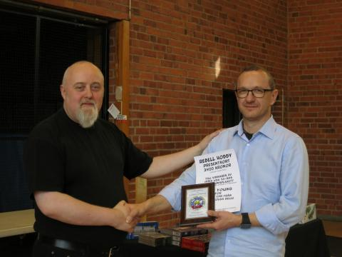 Mr. Sven Young receiving award from IPMS Sweden President, Jan Nilsson